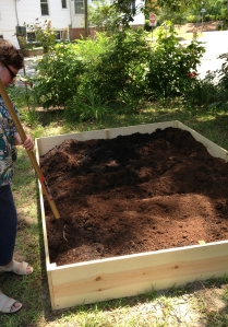 Mixing in peat moss.