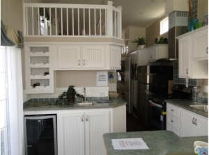 Kitchen area with wine cooler.