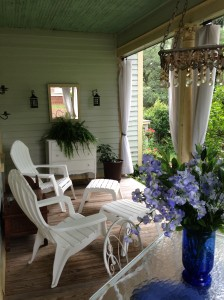 The porch wraps around the side and forms a private viewing area over the garden.