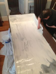 Here Melissa demonstrates how to paint with white primer while wearing black.