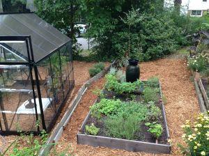 Fresh layer of Cypress mulch throughout the garden.