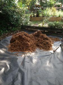 Adding Cypress mulch.