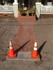 New front walk made of brick with granite step up from sidewalk.