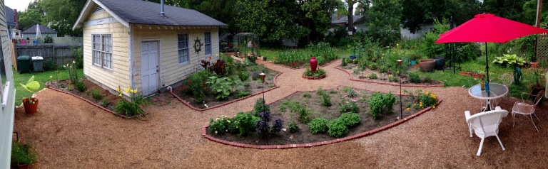 Potager cypress mulch paths have been expanded and a new red umbrella added.