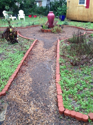 One of the walks becomes a channel of flowing water carrying away the mulch.