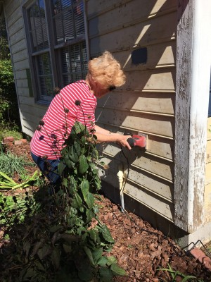 Mother trying her hand at sanding.