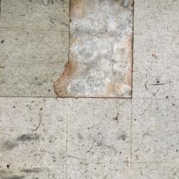 Crumbling asbestos tiles.