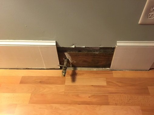 The natural gas line sticks out from the wall. The heater box stand is placed over this so the heater does not sit too far from the wall.