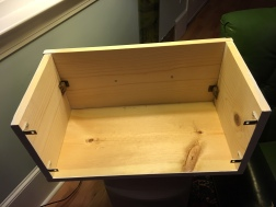 The box is bracketed to the moulding and the front panel is held is place by magnetic clasp.